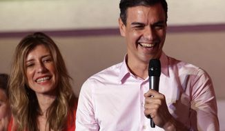 Spanish Prime Minister and Socialist Party candidate Pedro Sanchez speaks to supporters gathered at the party headquarters waiting for results of the general election in Madrid, Sunday, April 28, 2019. Spain's governing Socialists won the country's national election Sunday but will need the backing of smaller parties to stay in power, while a far-right party rode a groundswell of support to enter the lower house of parliament for the first time in four decades, provisional results showed. At left is his wife Maria Begona Gomez. (AP Photo/Andrea Comas)