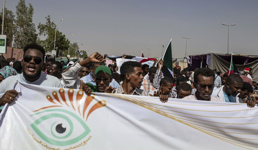 Protesters chant against military rule and demand the prosecution of former officials, at the Armed Forces Square, in Khartoum, Sudan, Sunday April 28, 2019. Sudanese protest leaders held talks with the ruling military council on Sunday after the military condemned an attack on an Islamist party close to President Omar al-Bashir, who was removed from power and jailed earlier this month. (AP Photos/Salih Basheer)