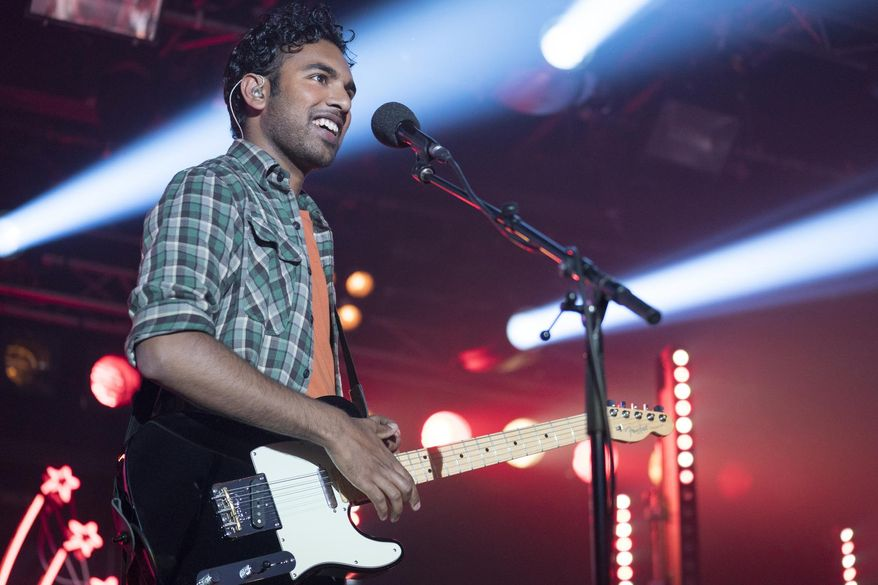 """This image released by Universal Pictures shows Himesh Patel in a scene from """"Yesterday,"""" directed by Danny Boyle. (Jonathan Prime/Universal Pictures via AP)"""