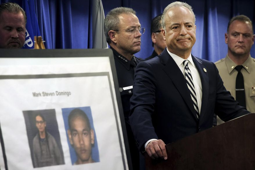 United States Attorney Nick Hanna stands next to photos of Mark Steven Domingo, during a news conference in Los Angeles on Monday, April 29, 2019. A terror plot by Domingo, an Army veteran who converted to Islam and planned to bomb a white supremacist rally in Southern California as retribution for the New Zealand mosque attacks was thwarted, federal prosecutors said Monday. (AP Photo/Richard Vogel) **FILE**