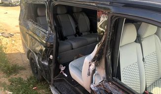 A view of the damaged vehicle involved in an accident near Alanya in Antalya province, Turkey, Monday, April 29, 2019. Czech Republic international Josef Sural was killed and six other Alanyaspor players were injured Monday when their van was involved in an accident on the way home from a Turkish league soccer match. (IHA agency via AP)