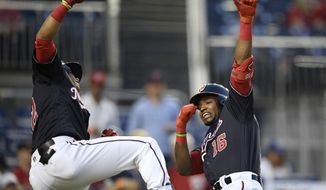 Washington Nationals' Victor Robles (16) celebrates his home run with Juan Soto, left, during the third inning of the team's baseball game against the St. Louis Cardinals, Tuesday, April 30, 2019, in Washington. (AP Photo/Nick Wass) **FILE**