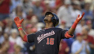 Washington Nationals' Victor Robles celebrates his home run during the third inning of the team's baseball game against the St. Louis Cardinals, Tuesday, April 30, 2019, in Washington. (AP Photo/Nick Wass)