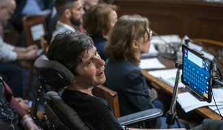 "Ady Barkan, a high-profile health care activist who suffers from Amyotrophic lateral sclerosis, testifies before the House Rules Committee at a hearing on a ""Medicare for All"" bill for government-provided health care, on Capitol Hill in Washington, Tuesday, April 30, 2019. (AP Photo/J. Scott Applewhite)"