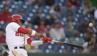 Washington Nationals left fielder Juan Soto bats during a baseball game against the San Diego Padres, Sunday, April 28, 2019, in Washington. The Nationals won 7-6 in 11 innings. (AP Photo/Nick Wass) ** FILE **