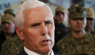 Vice President Mike Pence speaks to the media after a speech aboard the nuclear aircraft carrier USS Harry S. Truman at the Naval Station Norfolk in Norfolk, Va., Tuesday, April 30, 2019. (AP Photo/Steve Helber)