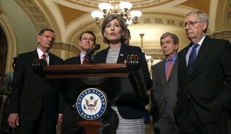 Sen. Joni Ernst, R-Iowa, joined from left by Sen. John Barrasso, R-Wyo., Sen. Todd Young, R-Ind., Sen. Roy Blunt, R-Mo., Senate Majority Leader Mitch McConnell, R-Ky., speaks to members of the news media following a Senate policy luncheon, Tuesday, April 30, 2019, on Capitol Hill in Washington. (AP Photo/Patrick Semansky)