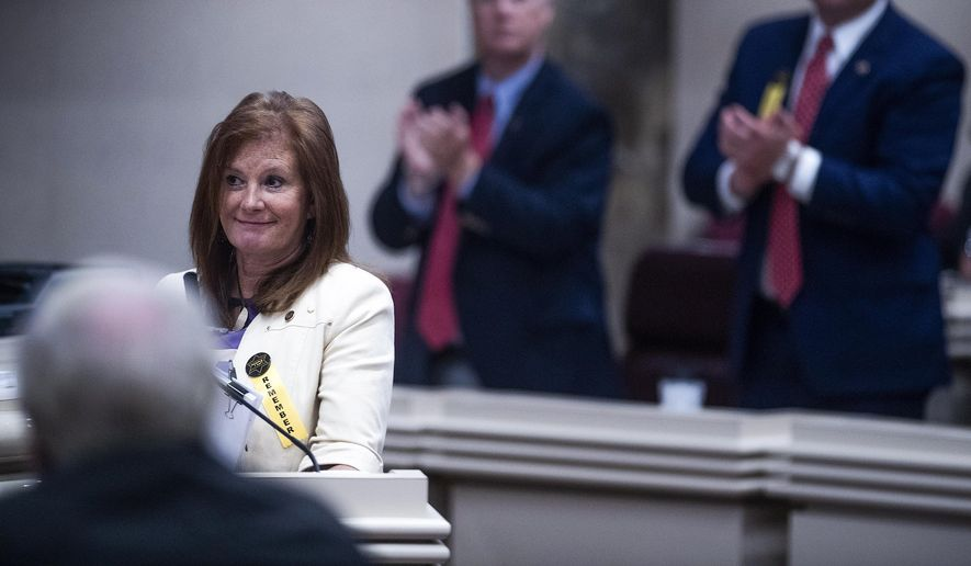 Rep. Terri Collins, R-Alabama, gets a standing ovation after her near-total-ban-on-abortion bill passed the House at the Alabama Statehouse in Montgomery, Ala., on Tuesday, April 30, 2019. (Mickey Welsh/The Montgomery Advertiser via AP)