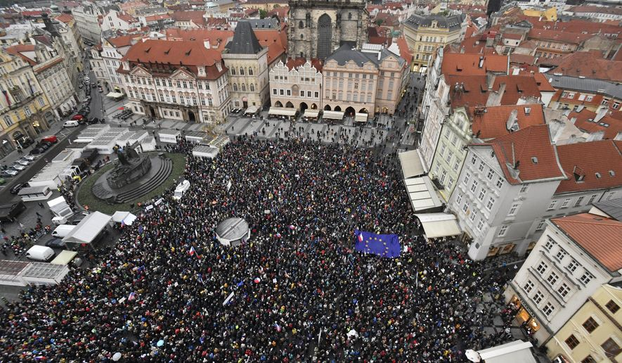 Thousands of people take part in a march in the centre of Prague, Monday April 29, 2019, to protest the proposed replacement of the justice minister. The protesters said Monday it might compromise the legal system at a time when prosecutors have to decide whether to indict Prime Minister Andrej Babis over alleged fraud involving European Union funds. (Vit Simanek/CTK via AP)