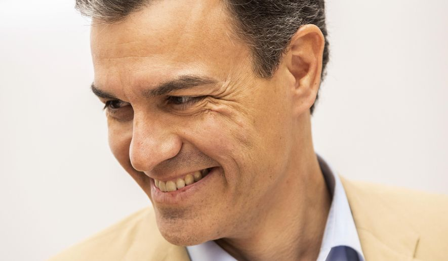 Spain's Prime Minister Pedro Sanchez smiles during a party meeting at Socialist party headquarters in Madrid, Spain, Monday, April 29, 2019. Spain's political future is no clearer after a third election since 2015, with experts saying Monday that it won't be anytime soon before the muddle is resolved. The incumbent prime minister, Pedro Sanchez, celebrated after his Socialist party won the most votes in Sunday's ballot. But Spanish politicians were doing the math on how Sanchez might survive the next four years without a parliamentary majority. (AP Photo/Bernat Armangue)