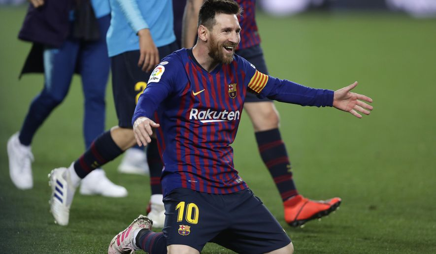Barcelona forward Lionel Messi celebrates winning the Spanish League title, at the end of the Spanish La Liga soccer match between FC Barcelona and Levante at the Camp Nou stadium in Barcelona, Spain, Saturday, April 27, 2019. Barcelona clinched the Spanish La Liga title, with three matches to spare, after it defeated Levante 1-0. (AP Photo/Manu Fernandez)