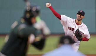 Boston Red Sox starting pitcher Rick Porcello delivers during the first inning of a baseball game against the Oakland Athletics at Fenway Park, Tuesday, April 30, 2019, in Boston. (AP Photo/Charles Krupa)