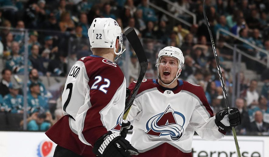 Colorado Avalanche's Colin Wilson (22) celebrates his goal with Tyson Barrie (4), right, against the San Jose Sharks in the second period of Game 1 of an NHL hockey second-round playoff series at the SAP Center in San Jose, Calif., on Friday, April 26, 2019. (AP Photo/Josie Lepe)