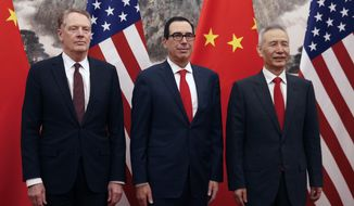 Chinese Vice Premier Liu He, right, poses with U.S. Treasury Secretary Steven Mnuchin, center, and U.S. Trade Representative Robert Lighthizer, left, before they proceed to their meeting at the Diaoyutai State Guesthouse in Beijing, Wednesday, May 1, 2019. (AP Photo/Andy Wong, Pool)