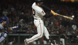 San Francisco Giants' Evan Longoria connects for a three-run double off Los Angeles Dodgers' Dylan Floro in the seventh inning of a baseball game, Monday, April 29, 2019, in San Francisco. (AP Photo/Ben Margot)