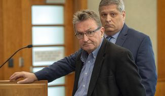 Sterling Van Wagenen, left, pleads guilty during his initial appearance in American Fork, Utah, on Tuesday, April 30, 2019. Prosecutors charged Van Wagenen earlier this month on accusations that he inappropriately touched a young girl on two occasions between 2013 and 2015. The 71-year-old co-founded a Utah film festival that came to be known as Sundance Film Festival with Robert Redford, but hasn't been with the organization for more than two decades. (Rick Egan /The Salt Lake Tribune, via AP, Pool)