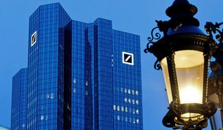 FILE-In this Feb. 1, 2019 file photo the Deutsche Bank headquarters is seen behind a lamp ahead of the annual press conference in Frankfurt, Germany. President Donald Trump has gone to court to fight an attempt by the House to obtain his business records. On Monday the president and three of his children filed suit in federal court in New York against Deutsche Bank and Capital One. (AP Photo/Michael Probst)