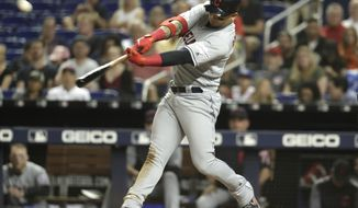 Cleveland Indians' Carlos Gonzalez hits a three-run home run during the third inning of the team's baseball game against the Miami Marlins, Tuesday, April 30, 2019, in Miami. (AP Photo/Lynne Sladky)