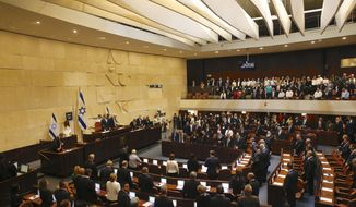 The general view of the plenum during the swearing in ceremony at the Caesar Premier Jerusalem in Jerusalem, Tuesday, April 30, 2019. Members of Israel's parliament are being sworn in at the Knesset, the country's legislature, three weeks after a tumultuous national election.(AP Photo/Ariel Schalit)