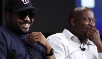 "FILE - In this July 29, 2008, file photo, Ice Cube, left, and director John Singleton, laugh during the ESPN panel for the documentary series ""30 for 30"" at the Television Critics Association summer press tour in Pasadena, Calif. Singleton, who died Monday, April, 29, 2019, brought issues of gang violence, the crack epidemic and police brutality gripping South Central Los Angeles in the early 1990s and influenced a generation of people of color. (AP Photo/Matt Sayles, File)"