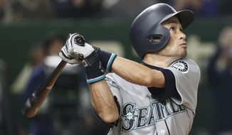 FILE - In this March 20, 2019, file photo, Seattle Mariners' Ichiro Suzuki pops out in the third inning of Game 1 of the Major League Baseball opening series against the Oakland Athletics at Tokyo Dome in Tokyo.  Suzuki has rejoined the Mariners as a special assistant to the chairman and will work as an instructor with both the major league club and some of the organization's players in the minors. (AP Photo/Koji Sasahara, File)
