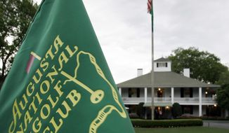 FILE - In this April 4, 2007, file photo, cloudy skies appear above the clubhouse at the Augusta National Golf Club in Augusta, Ga. Several members of a Texas family have been charged with federal crimes in what prosecutors say was a scheme that used stolen identities to get tickets to the Masters golf tournament, then resell those tickets at a healthy profit. (AP Photo/David J. Phillip, File)
