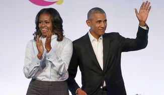 Former President Barack Obama, right, and former first lady Michelle Obama appear at the Obama Foundation Summit in Chicago, Oct. 31, 2017. (AP Photo/Charles Rex Arbogast) ** FILE **