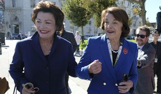 File - In this Nov. 5, 2018, file photo, U.S. Sen. Dianne Feinstein walks with former Congresswoman Ellen Tauscher outside City Hall in San Francisco. Former Democratic Rep. Ellen Tauscher of California, a trailblazer for women in the world of finance who served in congress for more than a decade before joining the Obama Administration, has died of complications from pneumonia. She was 67. Her family said in a statement Tuesday that Tauscher died Monday, April 29, 2019, at Stanford University Medical Center. (AP Photo/Eric Risberg, File)