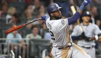 San Diego Padres Franmil Reyes hits a home run during the sixth inning of a baseball game against the Atlanta Braves, Tuesday, April 30, 2019 in Atlanta. (Curtis Compton/Atlanta Journal-Constitution via AP)