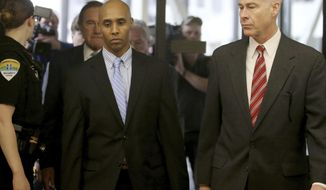 Former Minneapolis police officer Mohamed Noor walks through the skyway with his attorney Thomas Plunkett, right, on the way to court for the verdict Tuesday, April 30, 2019, in Minneapolis, Minn. The Minneapolis police officer was convicted of murder in the fatal shooting of an unarmed woman who approached his squad car minutes after calling 911 to report a possible rape behind her home. (David Joles/Star Tribune via AP)