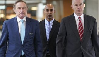 Former Minneapolis police officer Mohamed Noor heads into Hennepin County Government Center in Minneapolis to hear the verdict in his trial, Tuesday, April 30, 2019. The Minneapolis police officer was convicted of murder in the fatal shooting of an unarmed woman who approached his squad car minutes after calling 911 to report a possible rape behind her home. (Renee Jones Schneider/Star Tribune via AP)