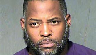 FILE - This undated file photo provided by the Maricopa County Sheriff's Department shows Abdul Malik Abdul Kareem. Kareem was convicted of providing guns to Elton Simpson and Nadir Soofi, two Islamic State followers who attacked a Prophet Muhammad cartoon contest nearly four years ago in Garland, Texas. Kareem's attorneys say the FBI had installed a surveillance camera outside Simpson and Soofi's apartment, but didn't reveal the existence of the camera until three years after their client's trial. (Maricopa County Sheriff's Department via AP, File)