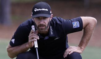 Dustin Johnson lines up a putt on the sixth green during the final round of the RBC Heritage golf tournament at Harbour Town Golf Links on Hilton Head Island, S.C., Sunday, April 21, 2019. Johnson was the third round leader but shot a six over par 77 during the final round. (AP Photo/Mic Smith) **FILE**