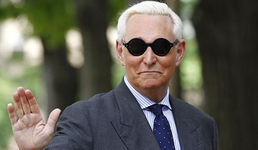 Roger Stone, former campaign adviser for President Donald Trump, waves as he arrives at federal court for a hearing, Tuesday, April 30, 2019, in Washington. (AP Photo/Patrick Semansky) ** FILE **