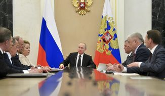 Russian President Vladimir Putin, center, chairs a Security Council meeting in Moscow, Russia, Tuesday, April 30, 2019. (Alexei Druzhinin, Sputnik, Kremlin Pool Photo via AP)