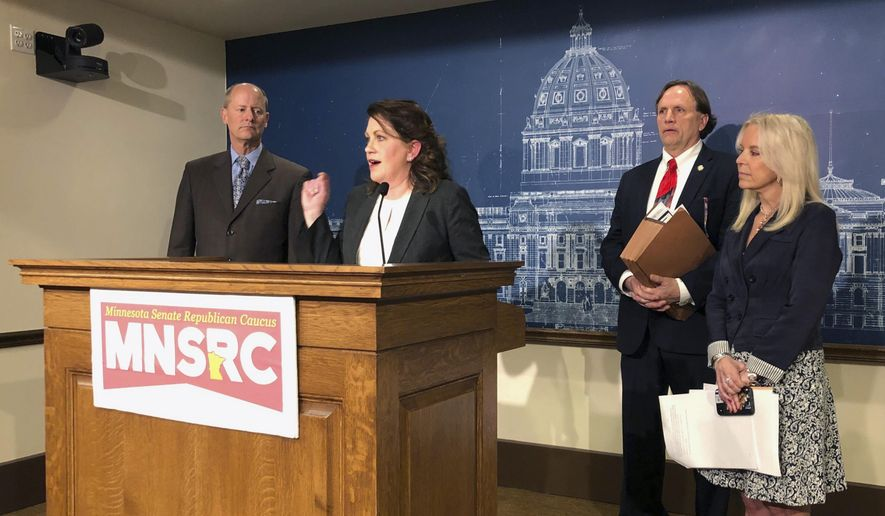 Minnesota State Sen. Michelle Benson, center, discusses the Senate GOP health and human services budget bill during a news conference at the state Capitol in St. Paul, Minnesota, Tuesday, April 30, 2019. Also participating are from left, Senate Majority Leader Paul Gazelka, Benson, Sen. Jim Abeler, and Sen. Karin Housley. Senate Republicans say their health and human services budget bill would provide good care for the elderly, the disabled and children who need it while cracking down on fraud and waste. (AP Photo/Steve Karnowski)