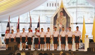 """FILE - In this Sept. 6, 2018. file photo, members of the Wild Boars, the soccer team that was rescued from a flooded cave, give thanks in front of Thailand King Maha Vajiralongkorn's image during an event titled """"United as One"""" in Bangkok, Thailand. The U.S. streaming video giant Netflix has officially announced Tuesday, April 30, 2019, it will join with the production company for the movie Crazy Rich Asians to make a film about last July's dramatic rescue of 12 village boys who were trapped with their soccer coach in a flooded cave in northern Thailand for more than two weeks. (AP Photo/Sakchai Lalit, File)"""