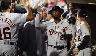 Detroit Tigers' Niko Goodrum celebrates his homer with one run batted in off of Philadelphia Phillies' Vince Velasquez during the third inning of their baseball game, Tuesday, April 30, 2019, in Philadelphia. (AP Photo/Matt Rourke)