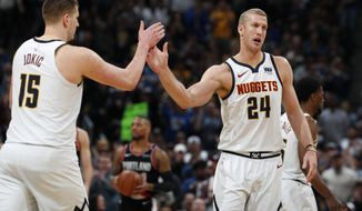 Denver Nuggets center Nikola Jokic, left, congratulates forward Mason Plumlee after Plumlee scored a basket against the Portland Trail Blazers in the second half of Game 1 of an NBA basketball second-round playoff series, Monday, April 29, 2019, in Denver. The Nuggets won 121-113. (AP Photo/David Zalubowski)
