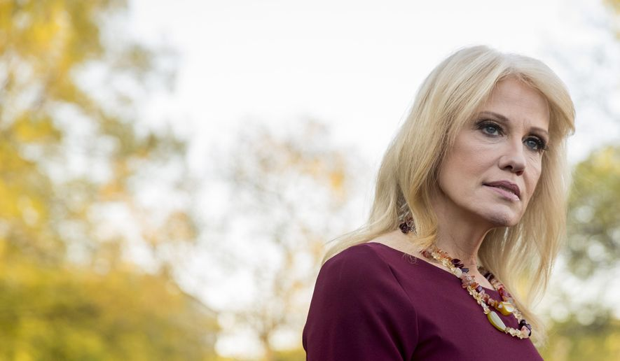 Counselor to the President Kellyanne Conway listens to a question from a reporter outside the West Wing of the White House, Tuesday, April 16, 2019, in Washington. (AP Photo/Andrew Harnik)