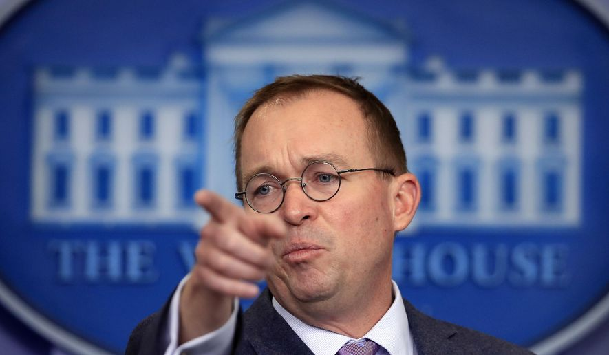 In this March 22, 2018 file photo, Office of Management and Budget Director Mick Mulvaney speaks in the Brady press briefing room at the White House in Washington. Mulvaney says he expects to stay on in his role though the 2020 election. (AP Photo/Manuel Balce Ceneta)