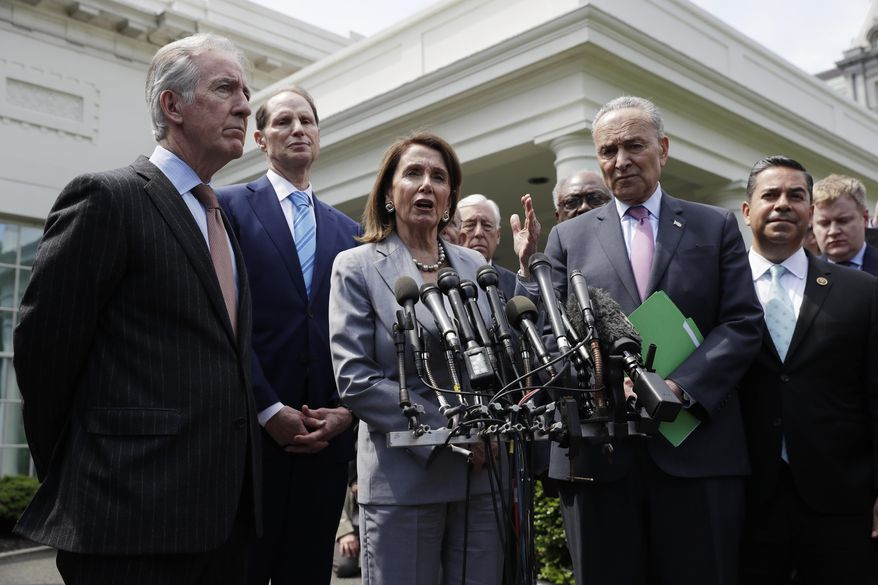 Speaker of the House Nancy Pelosi of Calif., Senate Minority Leader Sen. Chuck Schumer of N.Y. and other Democrats, talk to the media after meeting with President Donald Trump in the Cabinet Room of the White House, Tuesday, April 30, 2019, in Washington. (AP Photo/Evan Vucci)