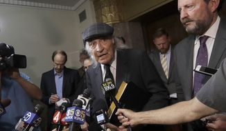 FILE - In this July 3, 2018, file photo, attorneys Tony Serra, center, and Brian Getz, right, representing Derick Almena, speak to reporters at a courthouse in Oakland, Calif. More than two years after 36 people died in the fire, Almena and Max Harris, the two men who face charges of involuntary manslaughter, will stand trial on charges that they allegedly illegally converted the industrial building into an unlicensed entertainment venue and artist live-work space. (AP Photo/Jeff Chiu, File)