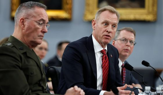 Acting Defense Secretary Patrick M. Shanahan, flanked by Joint Chiefs of Staff Chairman Gen. Joseph F. Dunford (left) and acting Deputy Secretary of Defense David Norquist, warned a House Appropriations subcommittee Wednesday about China's aggressive military buildup. (Associated Press)