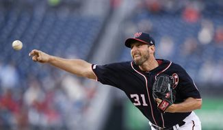 Washington Nationals starting pitcher Max Scherzer throws during the first inning of the team's baseball game against the St. Louis Cardinals, Wednesday, May 1, 2019, in Washington. (AP Photo/Nick Wass)