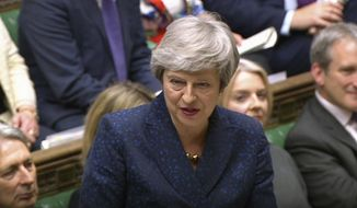In this grab taken from video, Britain's Prime Minister Theresa May speaks during Prime Minister's Questions in the House of Commons, London, Wednesday May 1, 2019. (House of Commons/PA via AP)