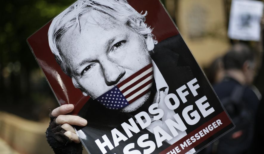 Protesters outside court as Julian Assange will appear to be sentenced on charges of jumping British bail seven years ago, in London, Wednesday, May 1, 2019. (AP Photo/Matt Dunham)
