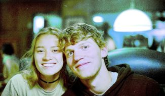In this Sept. 1, 2017, photo provided by Matthew Westmoreland, Riley Howell, right, is seen. Authorities say Howell, 21, was killed after he tackled a gunman who opened fire in a classroom at the University of North Carolina-Charlotte. Police said a few students, including Howell, died and several others were injured. Charlotte-Mecklenburg Police Chief Kerr Putney said Howell's actions likely saved the lives of other students. (Matthew Westmoreland via AP)