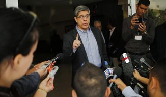 FILE - In this Dec. 12, 2018, file photo, Cuba's Director-General of U.S. Affairs Carlos Fernandez de Cossio makes a statement to reporters, in Havana, Cuba. De Cossio says his nation has no troops in Venezuela but it maintains the right to military and intelligence cooperation with its ally. (AP Photo/Desmond Boylan, File)