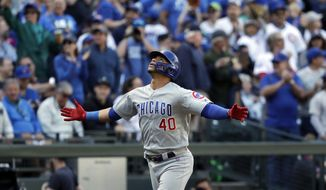 Chicago Cubs' Willson Contreras spreads his arms wide as he heads home on his solo home run against the Seattle Mariners in the fourth inning of a baseball game Wednesday, May 1, 2019, in Seattle. (AP Photo/Elaine Thompson)
